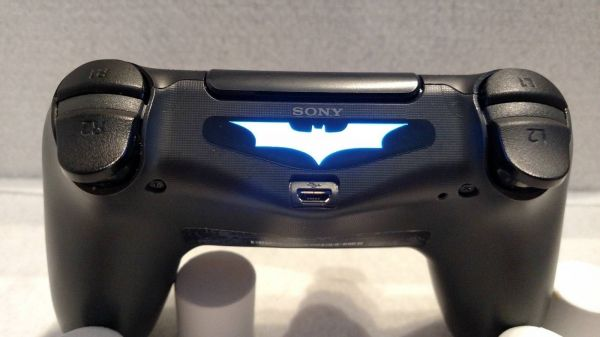 how to connect a dualshock 4 to a ps4
